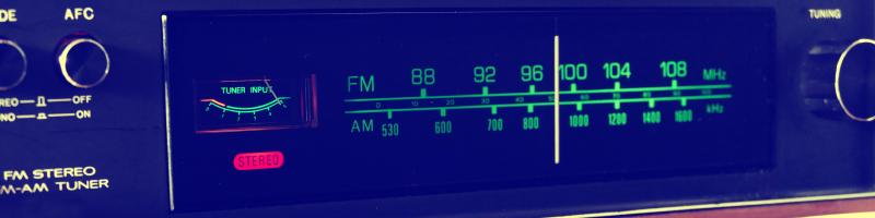 Stock photo of an FM receiver, from https://www.pexels.com/photo/analogue-buttons-design-display-157557/