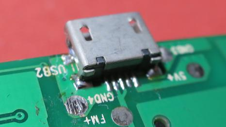 The USB connector soldered back on